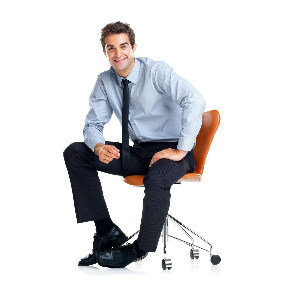 Handsome young businessman sitting on chair isolated over whiter background